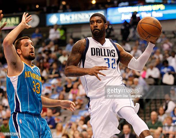 Dallas Mavericks shooting guard OJ Mayo makes a pass around New Orleans Hornets power forward Ryan Anderson on Wednesday April 17 in Dallas Texas