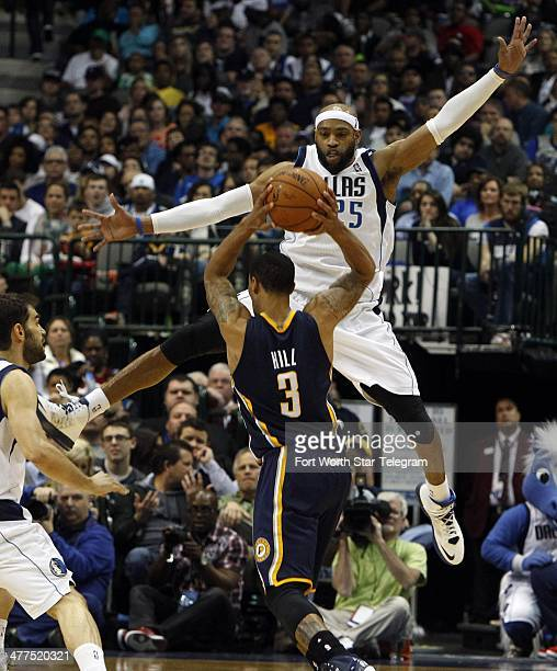 Dallas Mavericks shooting guard Vince Carter guards against the shot by Indiana Pacers point guard George Hill at the American Airlines Center on...