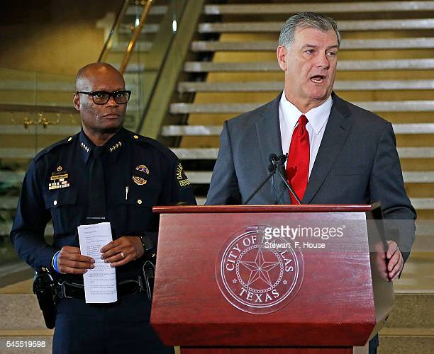 Dallas Mayor Mike Rawlings conducts a press conference at Dallas City Hall as Dallas Police Chief David Brown looks on following the fatal shootings...