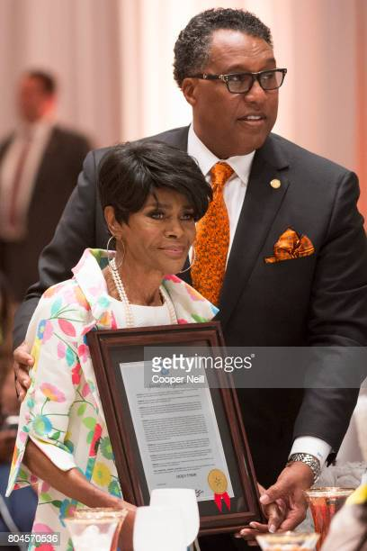 Dallas Mayor Pro Tem Dwaine Caraway presents Cicely Tyson with a gift during MegaFest's International Faith Family Film Festival at Omni Hotel on...