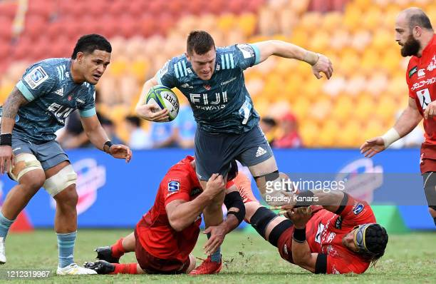 Dallas McLeod of the Crusaders takes on the defence during the round seven Super Rugby match between the Sunwolves and the Crusaders at Suncorp...