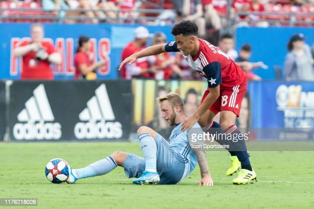 Dallas midfielder Brandon Servania and Sporting Kansas City forward Johnny Russell battle for the ball during the MLS soccer game between FC Dallas...