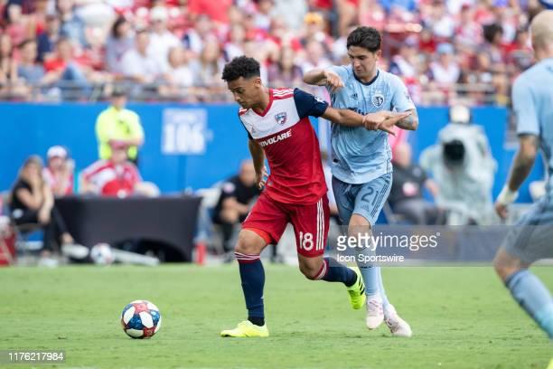 Dallas midfielder Brandon Servania dribbles as Sporting Kansas City midfielder Felipe Gutierrez defends during the MLS soccer game between FC Dallas...