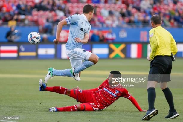 Dallas midfielder Javier Morales slide tackles against Sporting Kansas City defender Matt Besler during the MLS match between Sporting KC and FC...