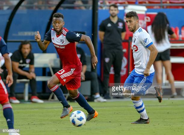 Dallas midfielder Kellyn Acosta and Montreal Impact midfielder Saphir Taider pursue a loose ball during the soccer match between the Montreal Impact...