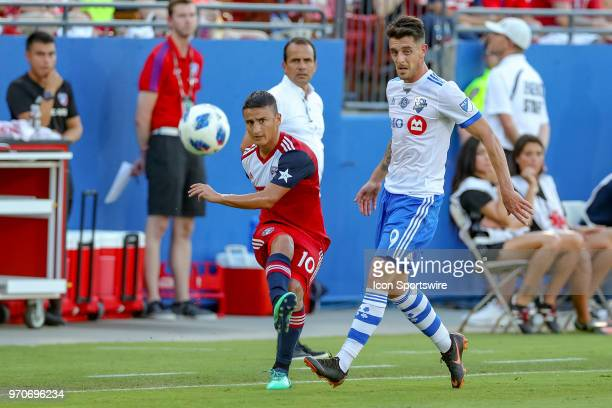 Dallas midfielder Mauro Diaz crosses the ball with Montreal Impact midfielder Alejandro Silva defending during the soccer match between the Montreal...