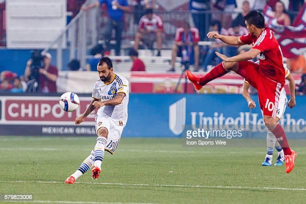 Dallas midfielder Mauro Diaz leaps towards a pass by Los Angeles Galaxy midfielder Juninho during the MLS match between the LA Galaxy and FC Dallas...