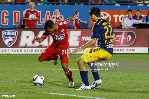 Dallas midfielder Michael Barrios battles to get a shot around New York Red Bulls defender Karl Ouimette during the MLS match between the New York...