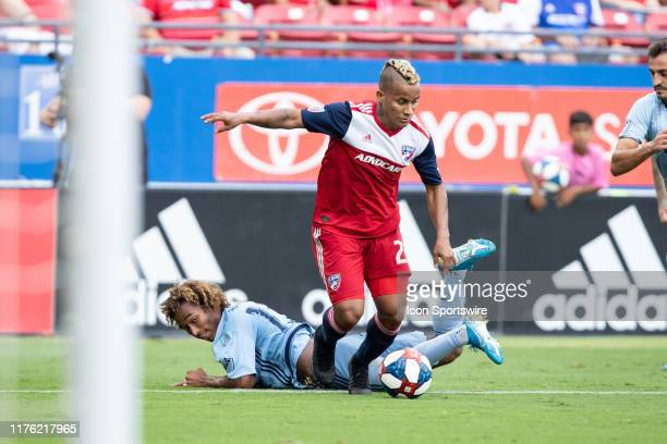 Dallas midfielder Michael Barrios dribbles past Sporting Kansas City midfielder Gianluca Busio during the MLS soccer game between FC Dallas and...