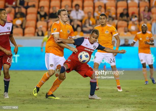 Dallas midfielder Michael Barrios keep the ball away from Houston Dynamo forward Andrew Wenger during the soccer match between FC Dallas and Houston...