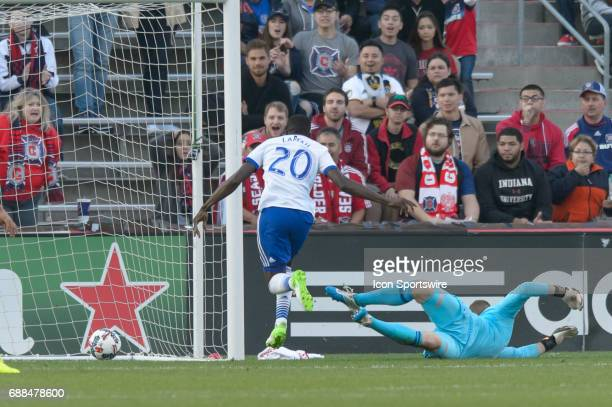 Dallas midfielder Roland Lamah scores on FC Dallas goalkeeper Chris Seitz in the first half during an MLS soccer match between FC Dallas and the...