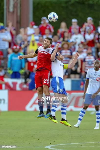 Dallas midfielder Ryan Hollingshead and Montreal Impact midfielder Samuel Piette battle for a header during the soccer match between the Montreal...