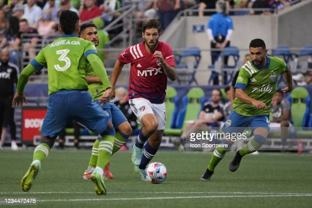 Dallas midfielder Ryan Hollingshead is surrounded by three Seattle defenders during an MLS match between FC Dallas and the Seattle Sounders on August...