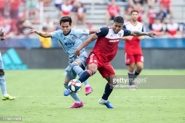 Dallas midfielder Santiago Mosquera and Sporting Kansas City midfielder Felipe Hernandez battle for the ball during the MLS soccer game between FC...