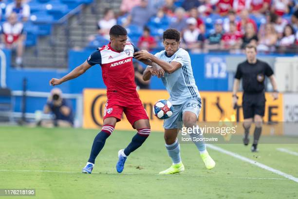 Dallas midfielder Santiago Mosquera battles for the ball with Sporting Kansas City defender Jaylin Lindsey during the MLS soccer game between FC...