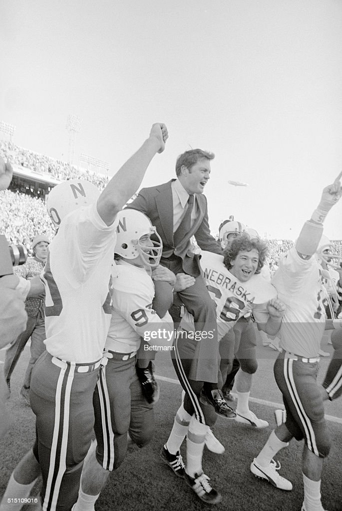 Teammates Carrying Coach Tom Osborne After Football Win : News Photo