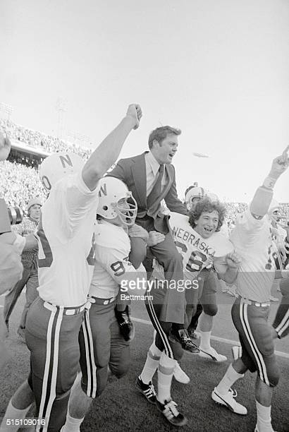 Dallas; Nebraska Cornhuskers Mike Offner and John Bell ( carry coach Tom Osborne off the field after they defeated the Texas Longhorns 19-3 in the...