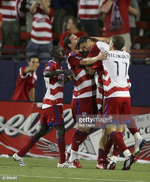Dallas players Dominic Oduro, Kenny Cooper, Andre Rocha and Aaron Pitchkolan pile onto Drew Moor to congratulate him after his goal in the 69th...
