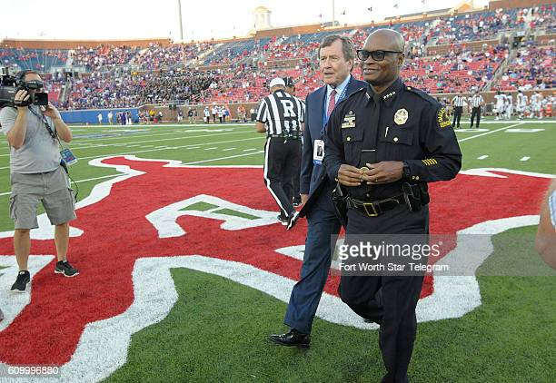 Dallas Police Chief David Brown conducts the coin toss as Texas Christian visits Southern Methodist at Gerald J Ford Stadium in Dallas on Friday Sept...