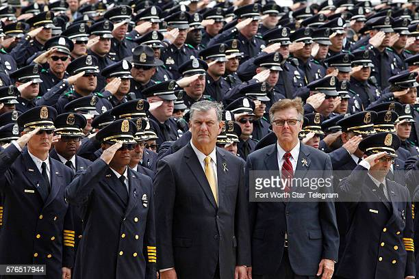 Dallas Police Chief David Brown Dallas mayor Mike Rawlings and Texas Lt Governor Dan Patrick stand at attention with hundreds of Dallas Police...