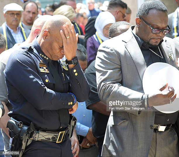Dallas Police Chief David Brown left prays at a prayer service at Thanksgiving Square in Dallas on Friday July 8 2016 On Thursday 12 police officers...