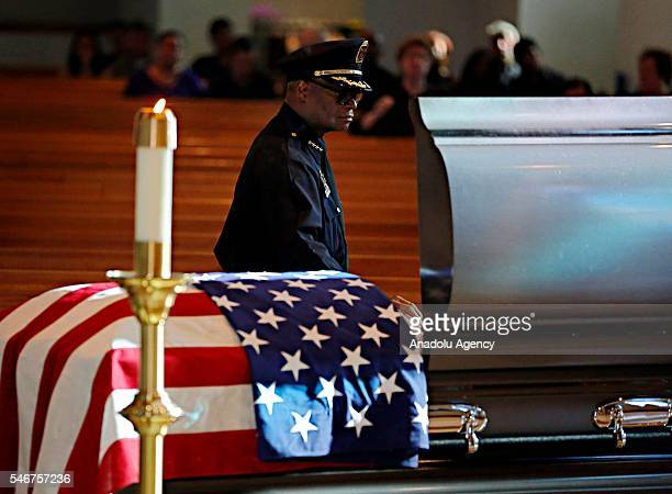 Dallas police Chief David Brown places his hand on a casket for slain Dallas police Sgt Michael Smith during a visitation for his body at Mary...