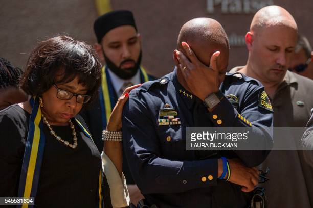 TOPSHOT Dallas Police Chief David Brown prays during a a vigil at ThanksGiving square in Dallas on July 8 following the shootings during a peaceful...