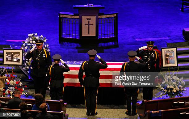 Dallas Police Honor Guard members stand alongside Ahrens' casket while three more arrive to replace them during the funeral service for Dallas police...