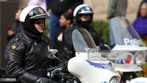 Dallas police officers arrive at the front of Hillary Clinton's motorcade Hillary Clinton spoke to supporters in downtown Fort Worth Texas Friday...