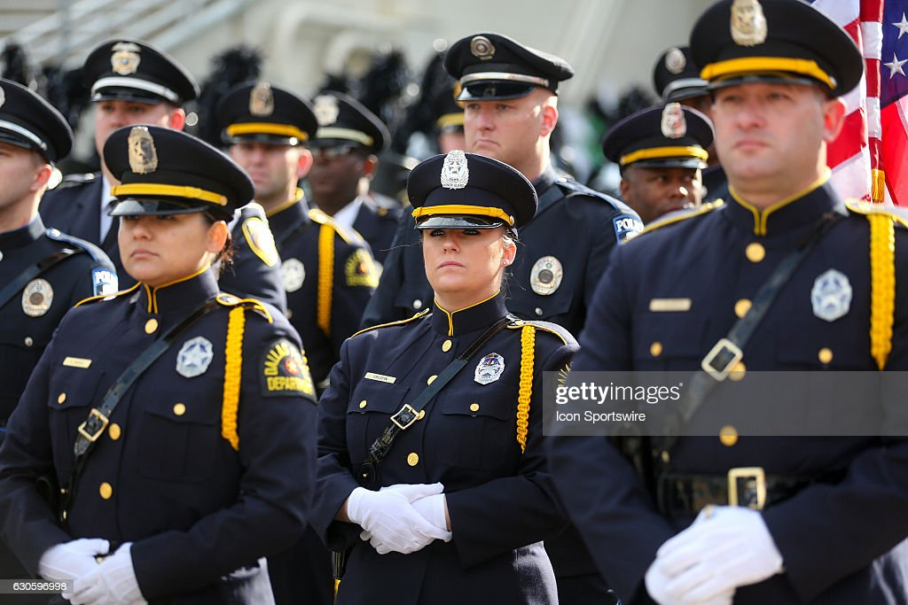 Dallas police officers at attention before the Zaxby's Heart