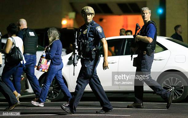Dallas police officers escort residents near the scene where eleven Dallas police officers were shot and five have now died on July 8 2016 in Dallas...
