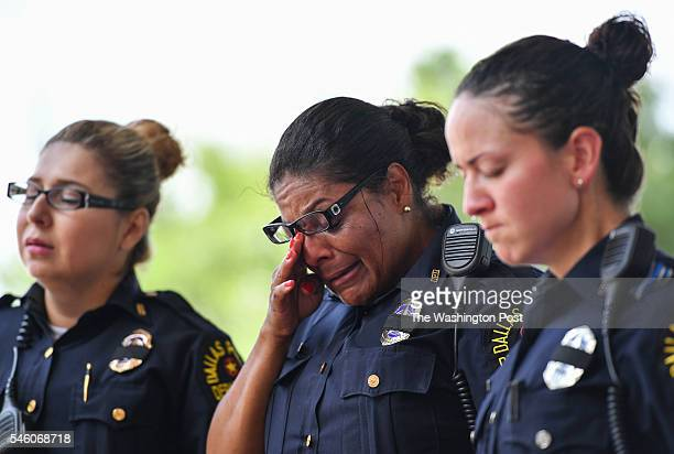 Dallas Police Sgt Amanda Renteria left Sgt Tanga Hampton center and officer Rebecca Tristan right are overcome with grief during a prayer service for...