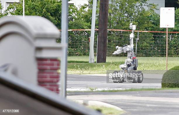 Dallas Police use a robot to gain access to an armoured van which authorities believed was rigged with explosives and was driven by a suspect who...