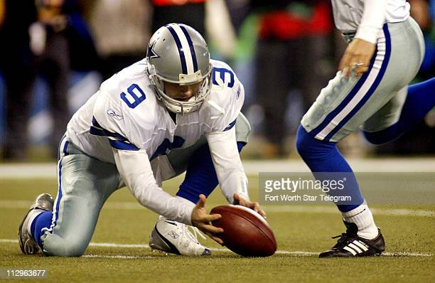Dallas quarterback Tony Romo mishandles the snap as kicker Martin Gramatica attempts a field against the Seattle Seahawks late in the NFC Wild Card...