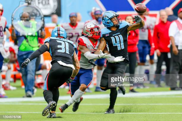 Dallas Renegades cornerback Dashaun Phillips defends the football against Houston Roughnecks wide receiver Kahlil Lewis during the game between the...