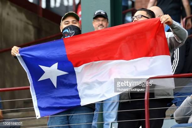 Dallas Renegades fans wave a Texas flag during the XFL football game against the St. Louis Battlehawks on February 09, 2020 in Arlington, Texas.
