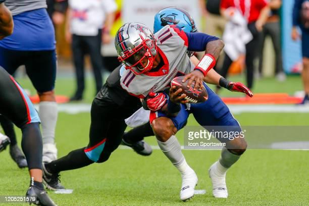 Dallas Renegades linebacker Greer Martini tries to sack Houston Roughnecks quarterback P.J. Walker during the game between the Dallas Renegades and...