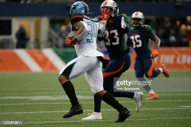 Dallas Renegades running back Cameron Artis-Payne stiff arms Seattle Dragons safety Jordan Martin during an XFL football game between the Dallas...