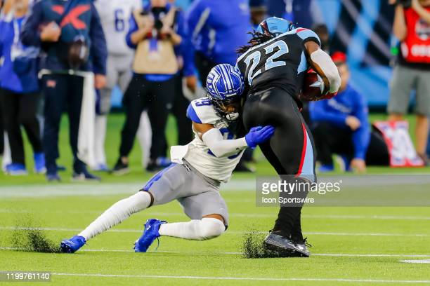Dallas Renegades running back Marquis Young tries to run past St Louis Battlehawks cornerback David Rivers during the game between the Dallas...