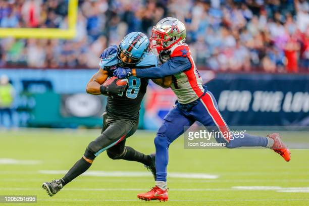Dallas Renegades wide receiver Freddie Martino gets tackled by Houston Roughnecks cornerback Ajene Harris during the game between the Dallas...