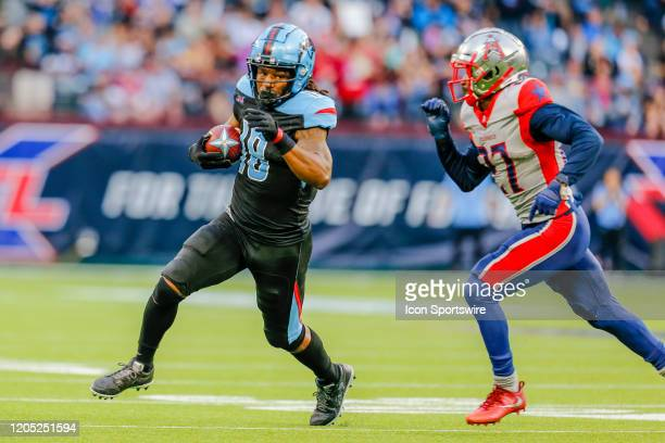 Dallas Renegades wide receiver Freddie Martino runs from Houston Roughnecks cornerback Ajene Harris during the game between the Dallas Renegades and...