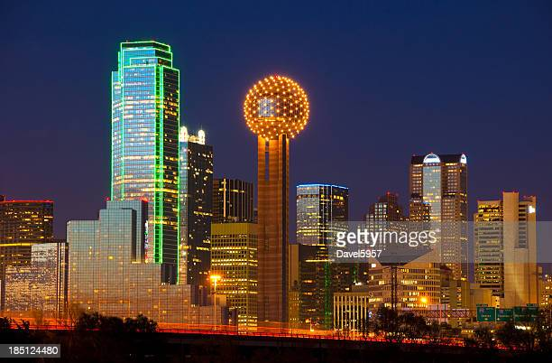 dallas skyline at dusk - the highrisers are all lit up - dallas stock pictures, royalty-free photos & images
