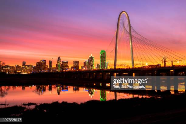 dallas skyline - sunrise with margaret hunt hill bridge - dallas, texas, texas - trinity river texas stock pictures, royalty-free photos & images