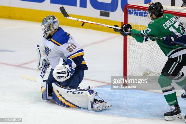 Dallas Stars center Andrew Cogliano attempts to deflect a shot that gets past St. Louis Blues goaltender Jordan Binnington during the game between...