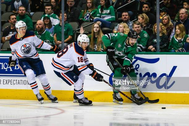 Dallas Stars center Devin Shore skates with the puck along the boards chased by Edmonton Oilers center Ryan Strome during the game between the Dallas...