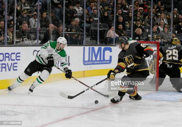 Dallas Stars center Jason Dickinson and Vegas Golden Knights defenseman Colin Miller battle for control of the puck during the second period of a...