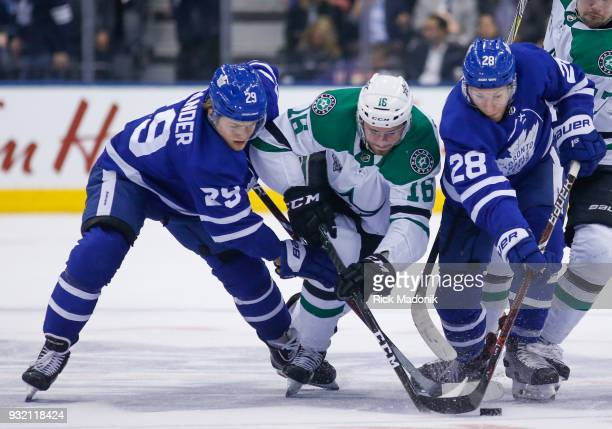 Dallas Stars center Jason Dickinson is sandwiched between Toronto Maple Leafs center William Nylander and Toronto Maple Leafs right wing Connor Brown...