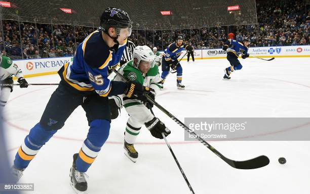 Dallas Stars center Jason Spezza and St Louis Blues defenseman Colton Parayko compete for the puck on the boards during a NHL game between the Dallas...