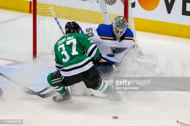 Dallas Stars center Justin Dowling attempts to screen a shot on St Louis Blues goaltender Jordan Binnington during the game between the St Louis...