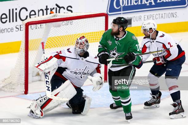 Dallas Stars center Martin Hanzal and Washington Capitals goalie Braden Holtby watch a puck that is deflected over the goal during the hockey game...
